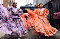 Two women preform traditional dance at a cultural festival in Mexico. Photo by sydney Rae on Unsplash.com.