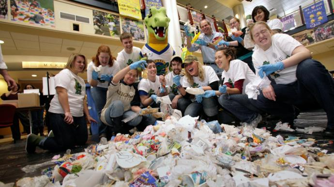 "Allegheny students sort through garbage to promote the college's ""One Less Cup"" campaign, which encourages reusable takeout containers. Allegheny College is a United Methodist affiliated college in Meadville, Pa. Photo by Bill Owen for Allegheny College."