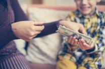 Mother teaches child about money and stewardship. Image © Liderina, iStockPhoto.com.
