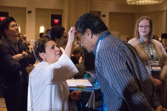 Louisiana Area Bishop Cynthia Fierro Harvey anoints the Rev. David Niu of the California-Nevada Conference during a reaffirmation of baptism service at Facing the Future 2018, an event for clergy in cross-racial/cross-cultural appointments hosted by the United Methodist Commission on Religion and Race in Newark, N.J. Photo by Joey Butler, UMNS.