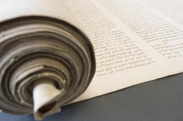 "The Bridwell Library Chinese Torah scroll dates to the mid-17th century, and its rendering of the Hebrew is in small, delicate handwriting, with brown ink. ""A rabbi or anyone who has read Torah scrolls their whole life opens this and says, `Wow, that's different,'"" said Eric White, Bridwell's Curator of Special Collections."