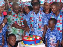 This year's J2J celebrants cut a birthday cake on June 26 at Bishop Baughman UMC in Freetown. Photo courtesy of Phileas Jusu