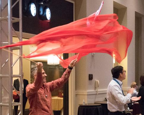 The Rev. Alex da Silva Souto, pastor of New Milford United Methodist Church in New Milford, Conn., and a co-convener of the United Methodist Queer Clergy Caucus, dances during worship at Facing the Future 2018. Photo by Joey Butler, UMNS.