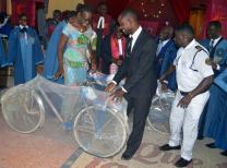 United Methodist lay leaders present clergy members with new bicycles at Emmanuel Port-Bouet 1 UMC  in Abidjan, Cote d'Ivoire. The bikes will help clergy evangelize in remote areas of the conference. Photo courtesy Emmanuel 1 COCOM