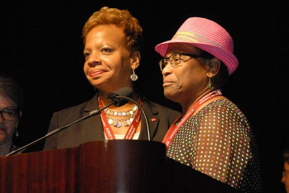 The Rev. Tracy Smith Malone (left, Northern Illinois Conference) is introduced by Maggie Jackson, North Central Jurisdiction Committee on Episcopacy chair, as a newly elected bishop of the North Central Jurisdiction. Smith Malone was elected July 13, 2016 on the sixth ballot. Photo courtesy of the North Central Jurisdiction.