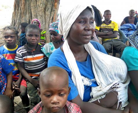 A woman holds a baby while seated among displaced people at a United Methodist church in Jalingo, Nigeria. United Methodist churches in Nigeria served as camps for people displaced after attacks on villages in Lau, a local government area in Taraba State in Northern Nigeria, in early 2017. Photo by the Rev. Ande I. Emmanuel.Photo by the Rev. Ande I. Emmanuel.