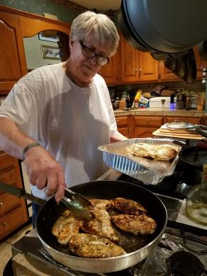 Lenny Kaplan is frying some of the 75 chicken breasts that Mosaic UMC serves each Wednesday to people in need. Photo courtesy of Mosaic United Methodist Church
