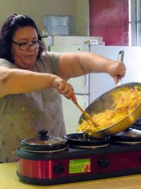 Up early on Sunday mornings, the Rev. Liliana Padilla cooks breakfast for the 9:30 a.m. Taco Service at San Pablo United Methodist Church, in Pearsall, Texas. She preaches at the 11 a.m. service. Photo by Sam Hodges, UMNS.