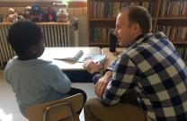 A member of The Gathering United Methodist Church in St. Louis works with a student at Washington Elementary School as part of the church's Literacy Project. Photo courtesy of The Gathering.