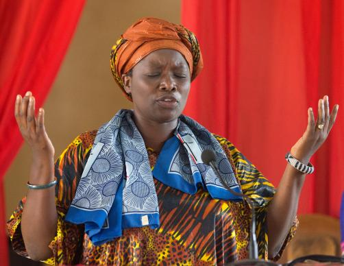 The Rev. Esther Kachiko Furaha prays during worship at New Jerusalem United Methodist Church in Uvira, Democratic Republic of Congo, in 2015. Photo by Mike DuBose, UMNS