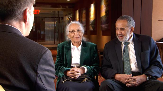 "The Rev. Gilbert H. Caldwell and his wife, Grace, are interviewed by Steve Hartman for an episode of ""On the Road"" at the site of where they had been denied lodging 60 years earlier. The Caldwells were turned away from the resort in the Poconos on their honeymoon because of their race. Photo courtesy of ""On the Road,"" CBS News."