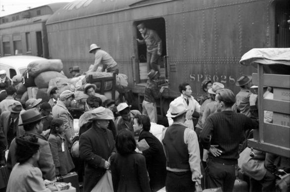 Japanese Americans going to internment camp Manzanar in Owens Valley gather around a baggage car at the old Santa Fe Station in Los Angeles, California, April 1942. Manzanar was one of 10 camps in the United States where over 110,000 Japanese Americans were forcibly removed (incarcerated) during World War II between December 1942 to 1945.