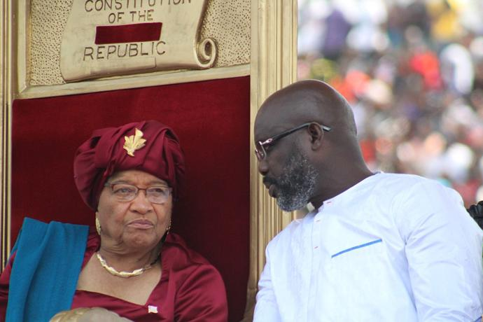 George Manneh Weah (right) visits with former president Ellen Johnson Sirleaf during Weah's inauguration as Liberia's president at Samuel Doe stadium in Monrovia. Both leaders are United Methodist. Photo by E Julu Swen, UMNS.