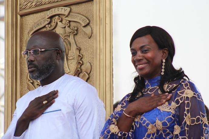 Liberian President George Manneh Weah and his wife, Clar Marie Weah, salute their flag during inauguration ceremonies in Monrovia. Photo by E Julu Swen, UMNS.
