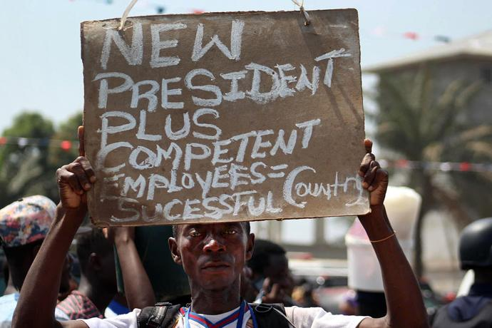 A spectator at the inauguration for Liberian President George Manneh Weah holds a sign stating his hopes for the country's future. Photo by E Julu Swen, UMNS.