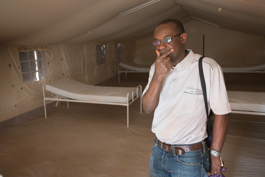 Dr. Simplice Adouko knows the threat of an Ebola outbreak is real in the border area between Côte d'Ivoire, Guinea and Liberia. Adouko, who normally works with HIV-AIDS patients, is standing in a a temporary Ebola containment and treatment center in Man.