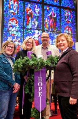 Members of Morrow Memorial United Methodist Church in New Jersey are helping a Syrian family. (From left) Andrea Wren-Hardin; Dorothy Wetzel; the Rev. Brad Motta, pastor at Morrow Memorial United Methodist Church, and Kathy Finch stand by the Advent wreath at the church. Photo by Jeff Wolfe