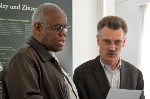 San Francisco Area Bishop Warner Brown Jr., left, joins with Peter Vogt, in reading a dialogue between John Wesley and Count Nikolaus Ludwig von Zinzendorf that Wesley later recounted. Methodism's founder and the Moravians' protector shared much in common but differed in their understanding of sanctification. Photo by Klaus Ulrich Ruof