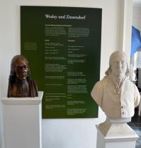 Busts of John Wesley, at left, and Count Nikolaus Ludwig von Zinzendorf stand side-by-side in a museum at the Moravian Congregation at Herrnhut, Germany. Photo by Klaus Ulrich Ruof