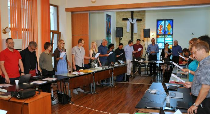 Participants in the European Methodist Council's September meeting in Ruse, Bulgaria, during devotions. Much of the meeting was devoted to a discussion of the current refugee crisis in Europe. Photo by Üllas Tankler, UMNS