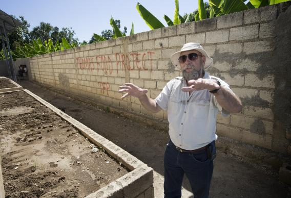 Warren McGuffin shows the raised-bed garden where okra has been planted at the Thomas Food Project in Thomas, Haiti. McGuffin is director of sustainability for the project. 2013 file photo by Mike DuBose, UMNS