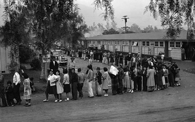 People line up for lunch at Santa Anita Park in April 1942. The park, a converted racetrack, was the United States' largest assembly center for Japanese Americans on their way to internment camps. Photo courtesy of Creative Commons/National Archives and Records Administration
