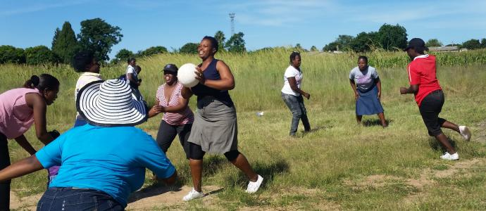 Tabitha Ruzyidzo, holding the ball, juggles roles of player, coach and referee during training sessions of the netball team of St. Peter's United Methodist Church in Chitungwiza, Zimbabwe. Photo by Eveline Chikwanah, UMNS