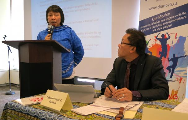 "Liberato ""Levi"" Bautista, right, an executive with the United Methodist Board of Church and Society, listens as Jeannie Sappa, an Inuk from Nunakvik in northern Quebec Province, discusses the situation of women in her indigenous community during a March 17 panel at the Church Center for the United Nations. Photo by Linda Bloom, UMNS"