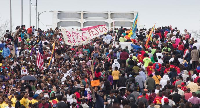 Marchers cross the Edmund Pettus Bridge in Selma, Ala., during the 50th anniversary observance of the