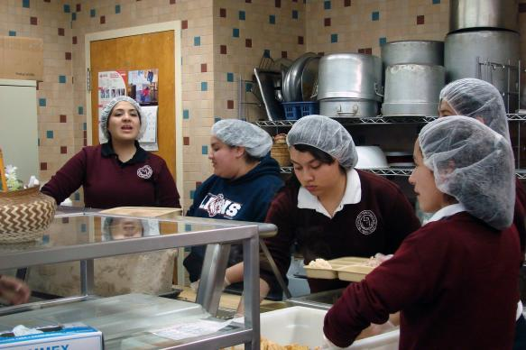 Students attending Lydia Patterson Institute on scholarship must work a campus job, and these girls help in the dining hall. Photo by Sam Hodges, UMNS
