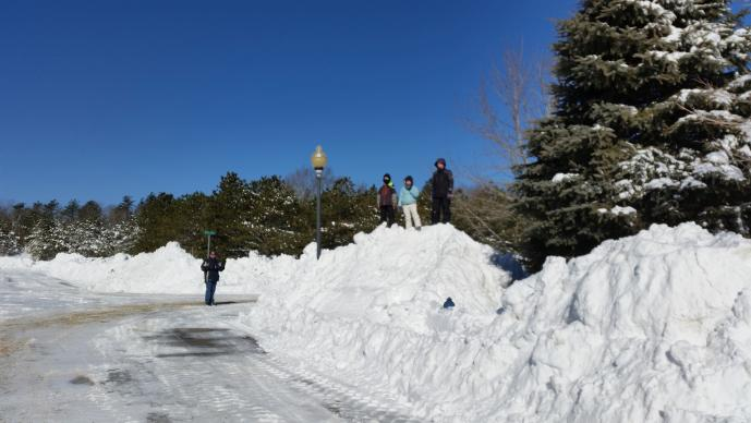 "Kids in Plymouth, Massachusetts play in snow on Treetop Way during what has been called ""Snowmagedon"" by many.  Photo by Mary Kenny"