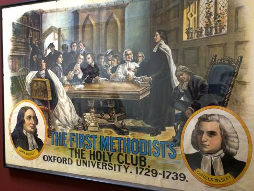 A poster hanging at the Commission on Archives and History celebrates the Holy Club that Charles and John Wesley led at Oxford University. Photo by Fran Walsh, United Methodist Communications