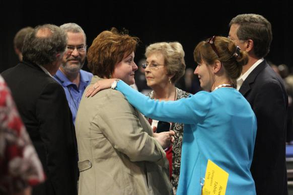 "Delegates  from the West Memphis and Tennessee Conferences (from left) David Reed, Sky McCracken, Selena Henson Sandra Burnett, Harriott Bryan and Randy Cooper, confer with each other following the decision of ""Plan UMC"" to be declared unconstitutional during the May 4 plenary of the 2012 United Methodist General Conference in Tampa, Fla."