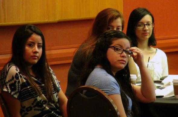 "(From left) Alma Torres, Ximena Villegas, (back) Melanie Gutierrez,  and Natalia Olivares listen during the MARCHA youth workshop on ""Social Holiness"" at MARCHA 2015. Photo by Michelle Maldonado, UMNS"