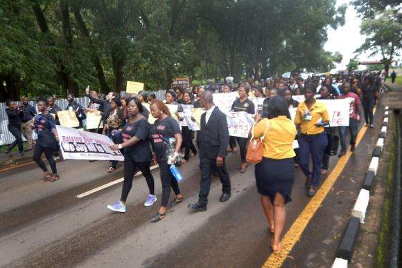 Dozens of men and women join together in the protest march against rape in Sierra Leone. United Methodist women were among the participants. Photo by Phileas Jusu, UMNS