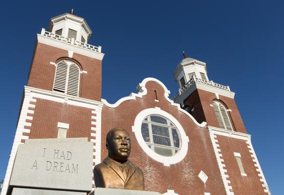 A bust of the Rev. Martin Luther King Jr. stands outside Brown Chapel African Methodist Episcopal Church in Selma, Ala. The church served as a staging area for voting rights protesters who were beaten by police during the