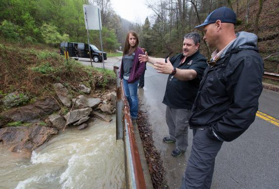 Earl Hampton (center) discusses water quality with Lauren Opizzi from the University of Tennessee (left) and Aaron Koch of the Kentucky Environmental Foundation near Red Bird Mission in Beverly, Ky. Hampton is work camp manager for the mission.