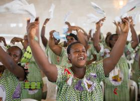 Isabelle Ake sings during worship at Temple Bethel United Methodist Church in Abobo-Baoule, outside Adidjan. Although worship in this West African country is still exuberant, the threat of Ebola is changing the way people interact. Photo by Mike DuBose, UMNS.