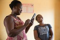 Rufine Yéi Sess Bottis (left) and her daughter Fidelia, 15,  live in Sipilou, Côte d'Ivoire. They prepared lunch and sang for guests visiting from U.S., Geneva and Abidjan.
