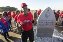 Jerry Chambers, a civil rights activist and retired educator from Dallas relates the story of Viola Liuzzo to students at her memorial on U.S. Hwy. 80 near White Hall, Ala.
