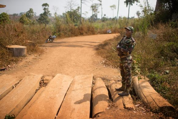 Sgt. Dongo Atta Blaise of the prefecture of Sipilou, Côte d'Ivoire, watches over a remote border crossing into Guinea. Until the first case of Ebola was Photos by Mike DuBose, UMNS.