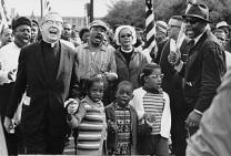 The Rev. Ralph Abernathy and his family march with the Rev. and Mrs. Martin Luther King on march from Selma to Montgomery in 1965. Courtesy: Abernathy Family/Wikimedia Commons.