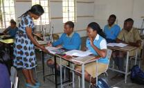 Angeline Mafemba confers with her students at Watershed College near Harare, Zimbabwe. Photo by Vicki Brown, UMNS