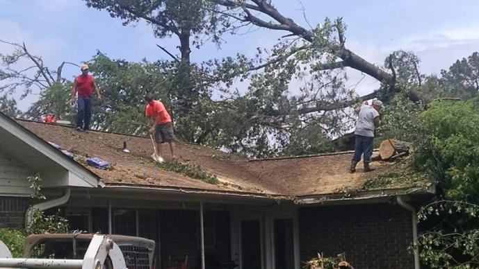 Volunteers begin clean up on the roof of a United Methodist Church parsonage in Nashville, Ark. Photo by Byron Mann, conference disaster response coordinator