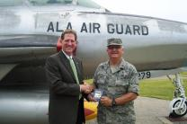 "Larry Coppock (left), acting executive director of Strength for Service and a staff member of the General Commission on United Methodist Men, presents a copy of ""Strength for Service to God and Country"" to Maj. Daryl R. Hamaker, chaplain of the 117th Air Refueling Wing in Birmingham, Ala. Photo courtesy of United Methodist Men"