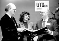 Roger Burgess (right), top staff executive of United Methodist Communications, visits with members of the Commission on Communications John Lovelace (left) and the Rev. Joan Gray in this UMCom file photo. Photo ca. 1989.