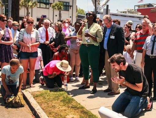 Mike Richards, a street pastor, invites people to kneel to pray and bless Charleston, S.C.  Photo by Lekisa Coleman-Smalls, UMNS