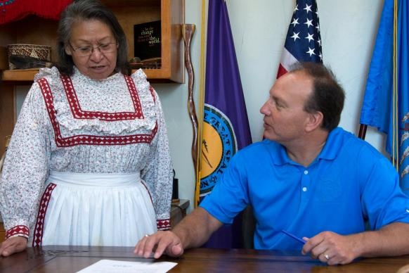"Chief Gary Batton of the Choctaw Nation signs a proclamation declaring the second Monday of October as ""Indigenous Peoples' Day."" Witnessing the signing is the Rev. Billie Nowabbi, a retired pastor in the Oklahoma Indian Missionary Conference. Photo courtesy of the Choctaw Nation of Oklahoma."