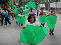 "More than 200 kids from 13 United Methodist local churches march with their ""pledges of action"" for keeping the Earth temperature down. The event took place in Cabanatuan City, Philippines."