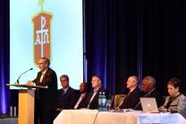 Bishop Bruce Ough speaks, as from left, Bishops Kenneth H. Carter, Marcus Matthews, Christian Alsted, Michael Watson,  Warner Brown and Cynthia Fierro Harvey listen during the May 2015 meeting in Berlin. Dakotas-Minnesota Area Bishop Ough, was elected next president of the Council of Bishops. Photo by Kay Panovec, United Methodist Communications